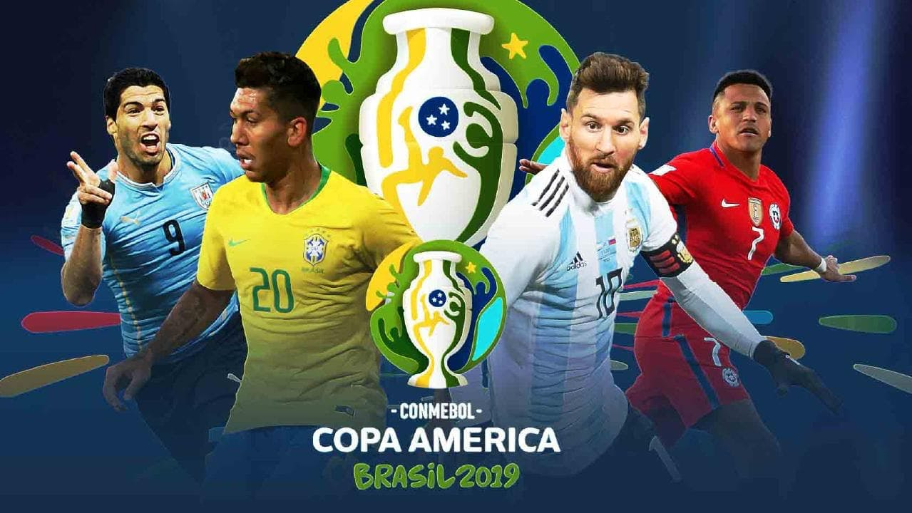 Luis Suarez holding a football ball