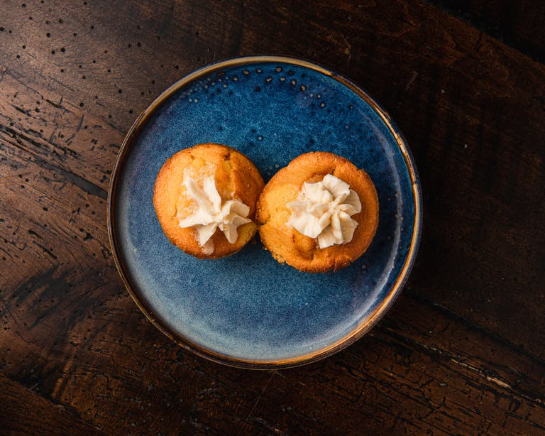 a bowl of oranges on a blue plate