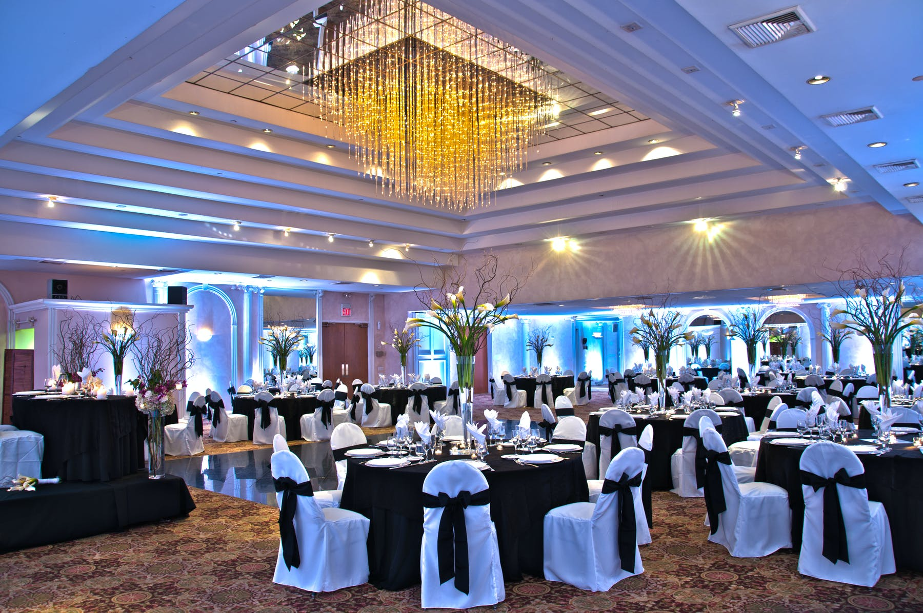 a room filled with decorated tables and chairs