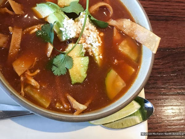 tortilla soup served on a white bowl