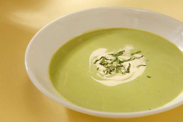 a soup served on a white bowl