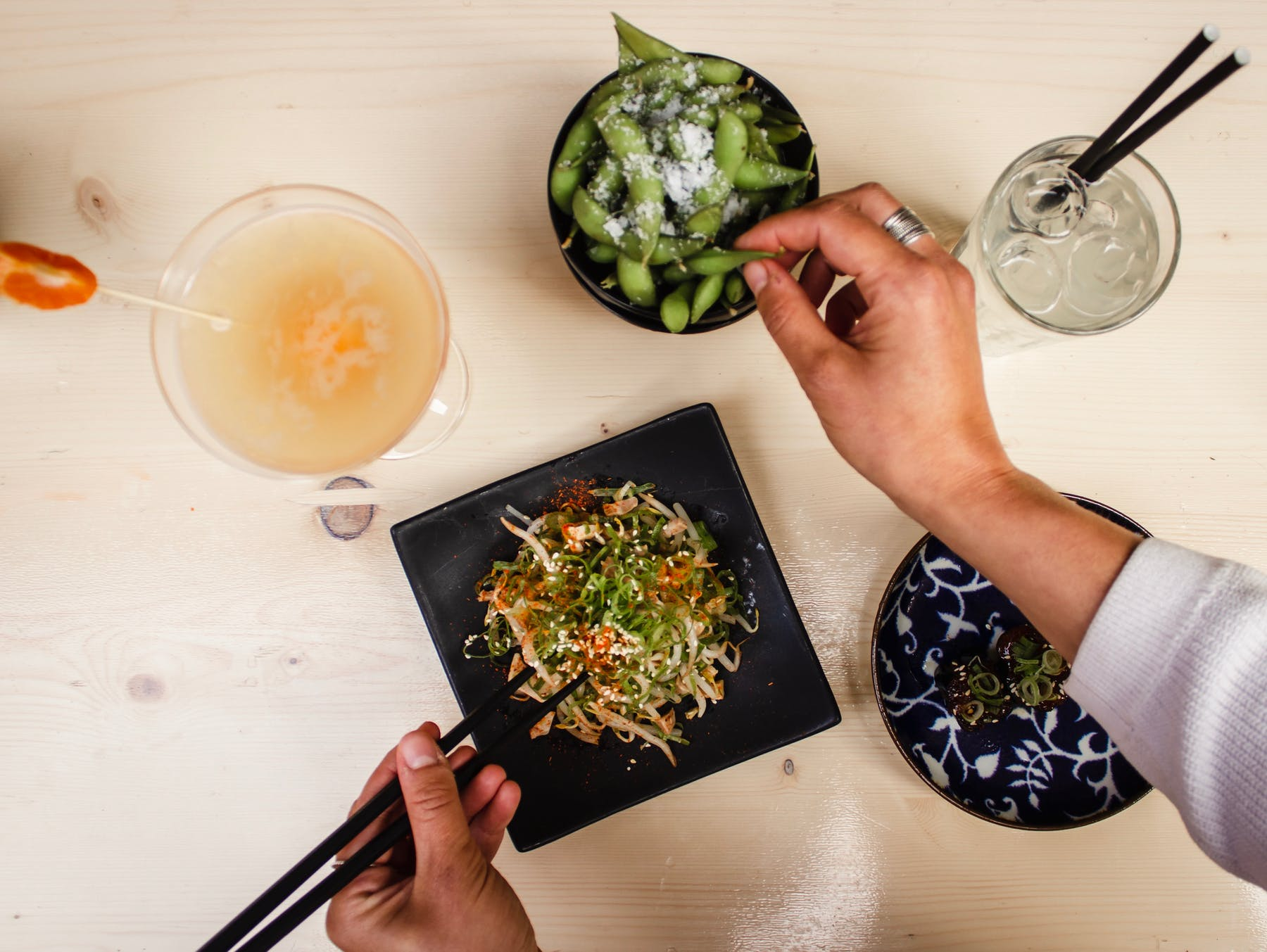 a person eating with chopsticks