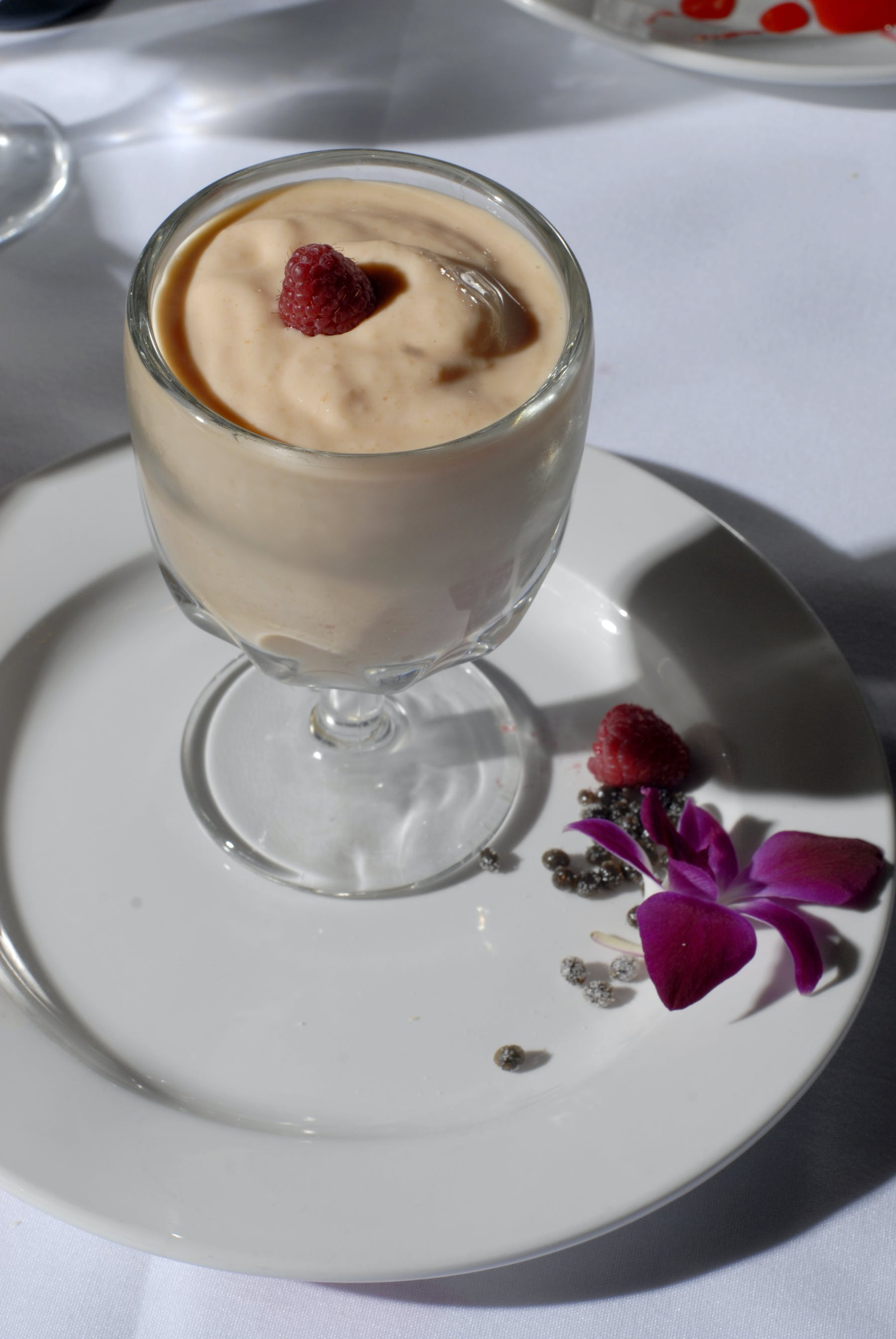a dessert on a plate next to a cup of coffee