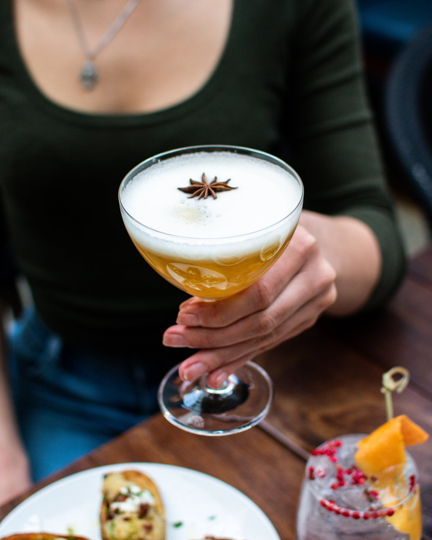 a person sitting with a cocktail