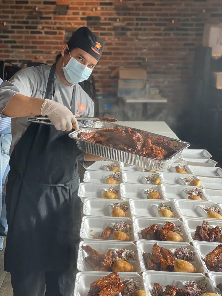 a man preparing food inside of a building