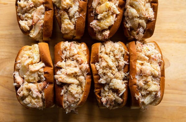 crab rolls lined up in a row