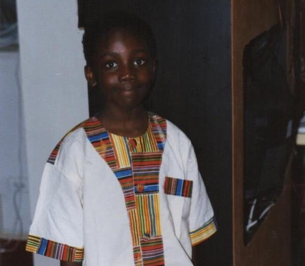 a young boy wearing a white shirt