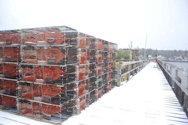 Lobster traps line the dock in the winter at Luke's at Tenants Harbor.