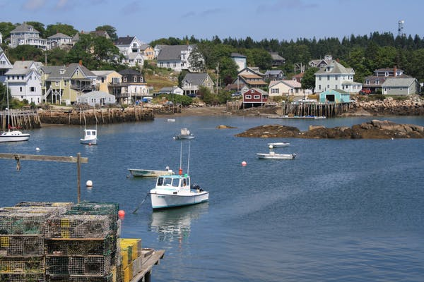 lobster boats in harbor coastal homes