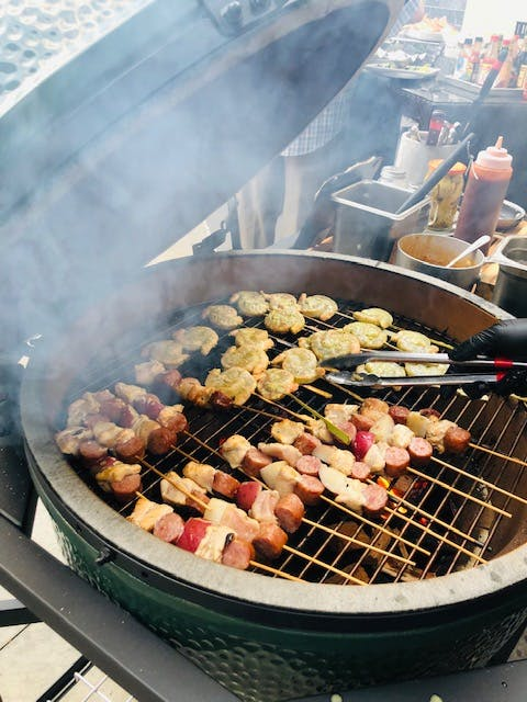 a group of meat cooking on a grill