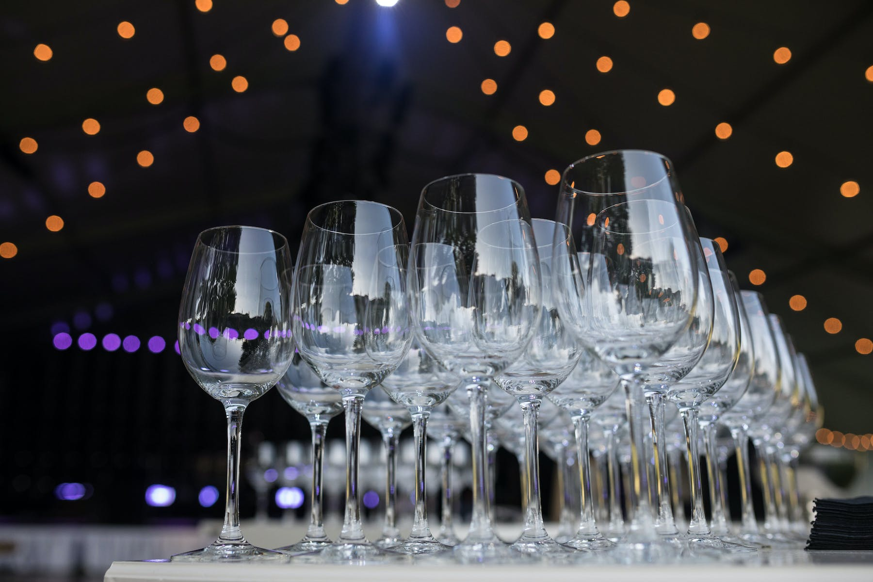 a row of wine glasses sitting on a table