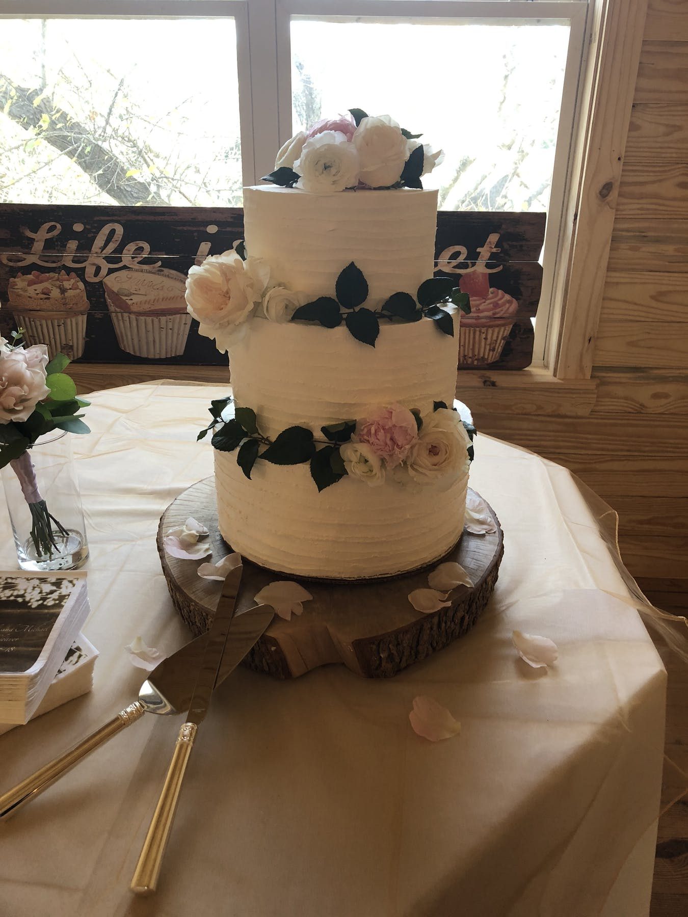 a wedding cake sitting on top of a table