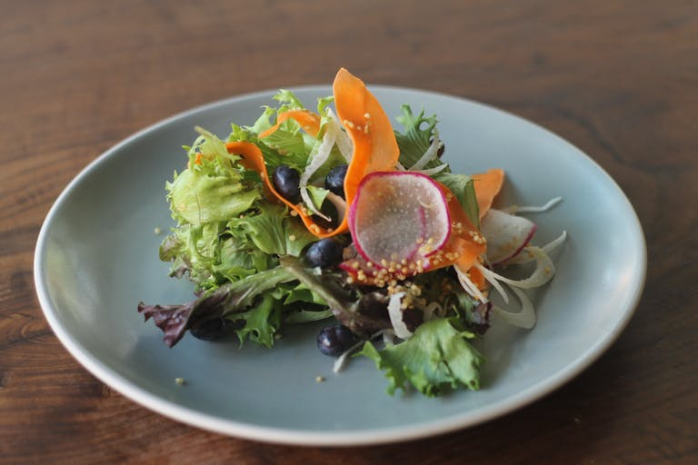 a bowl of salad on a plate