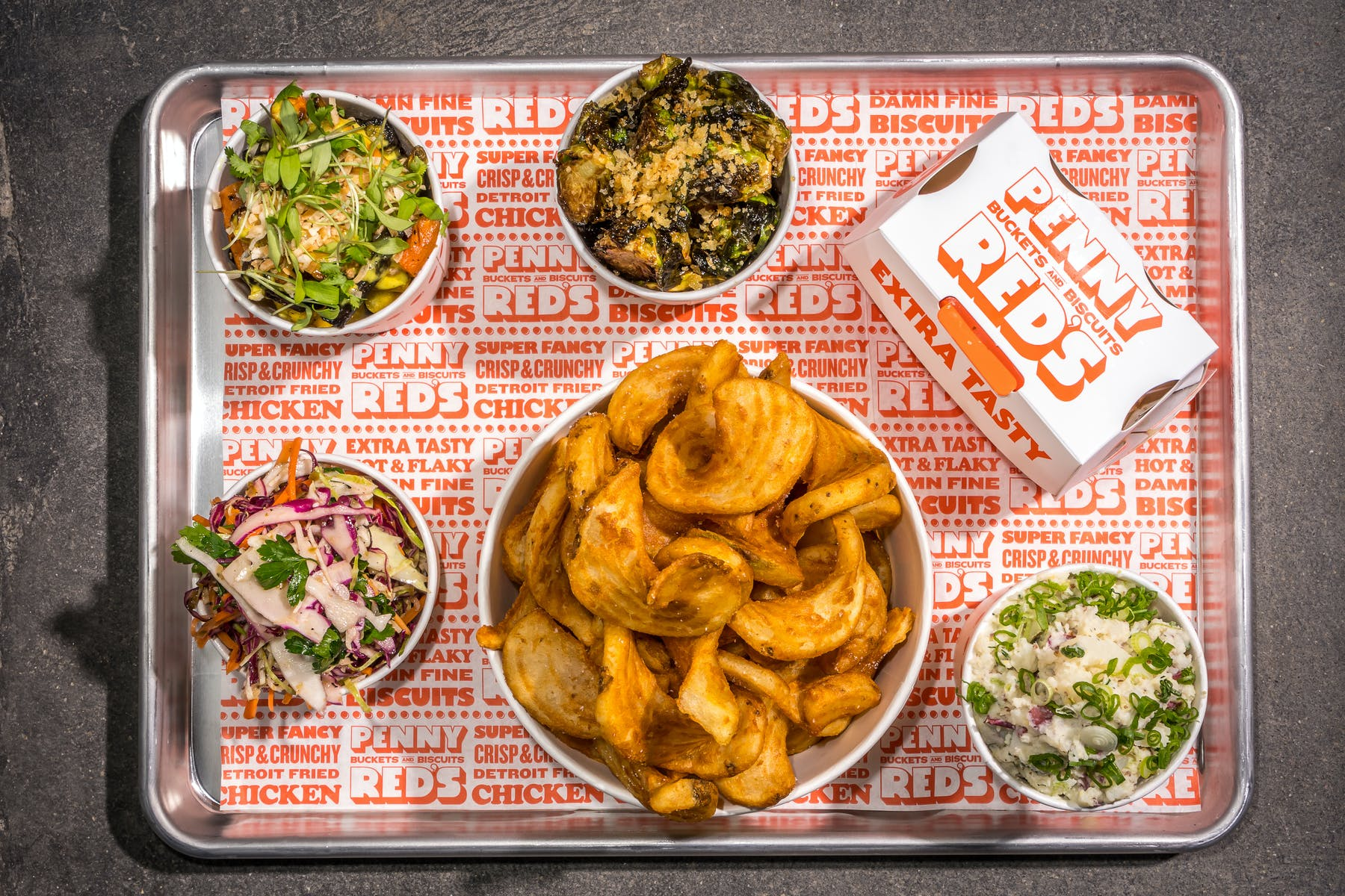 overhead shot of bucket of chicken and sides