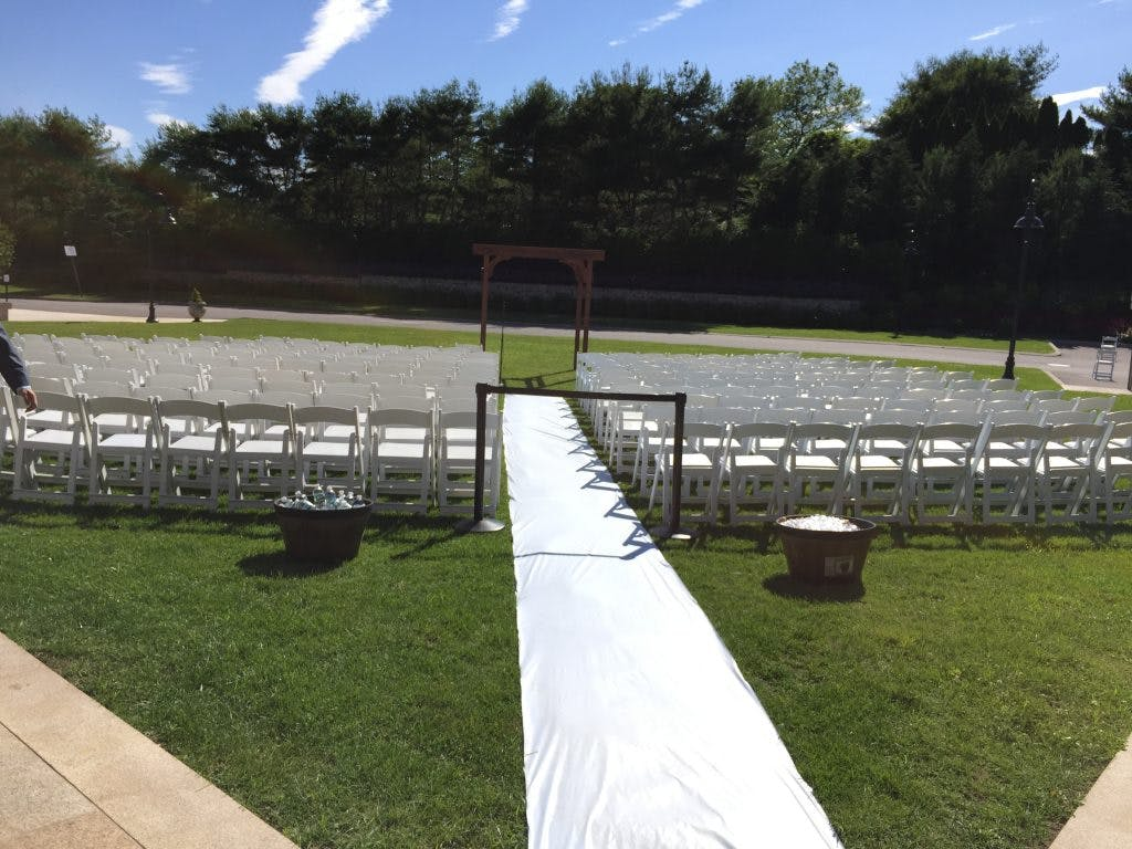 a field full of chairs and a white carpet