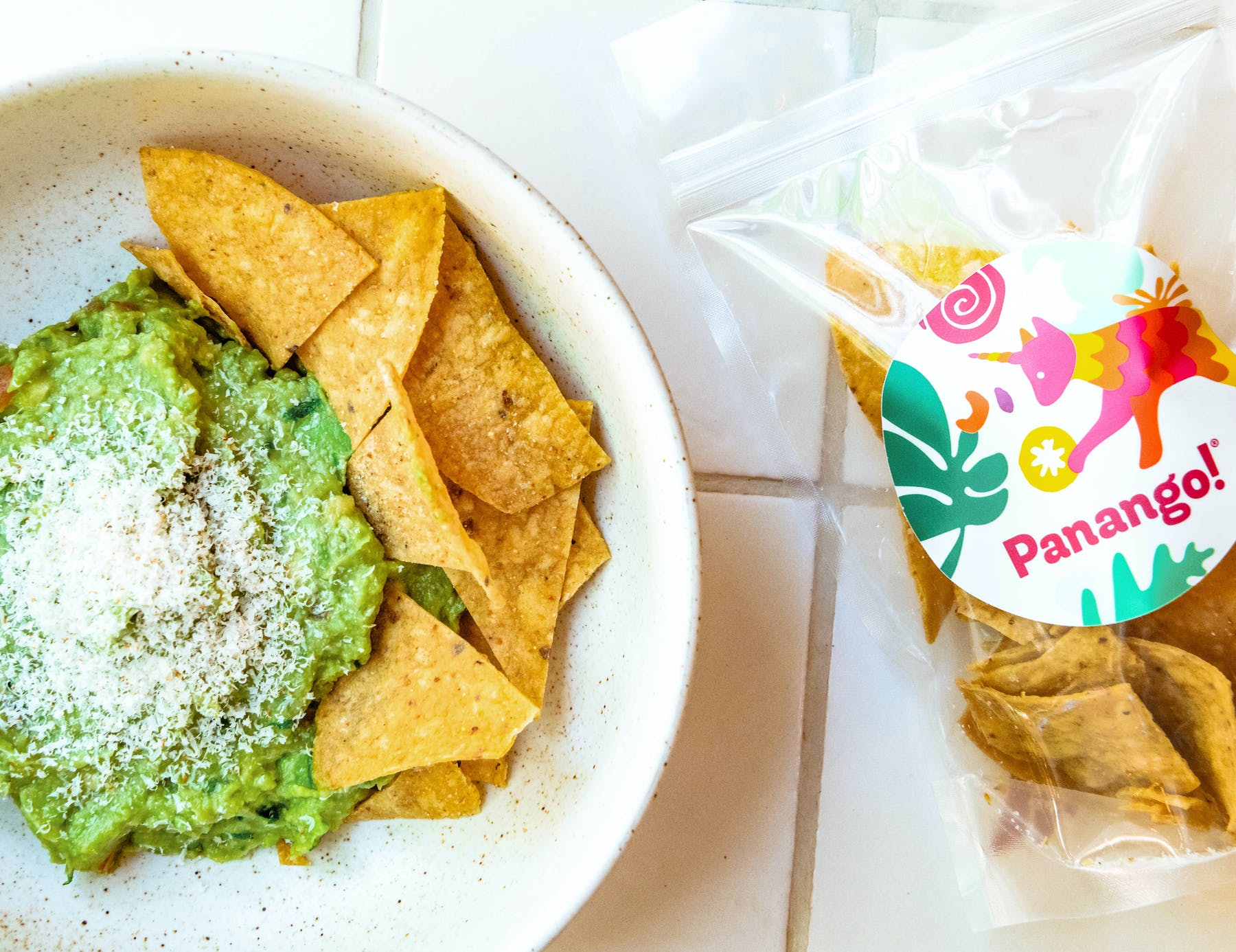 a plate of nachos and guacamole