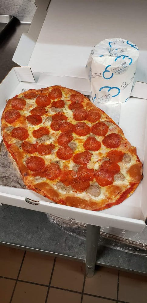 a pepperoni pizza in a box