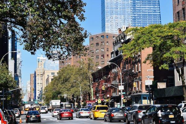 a car driving down a busy city street