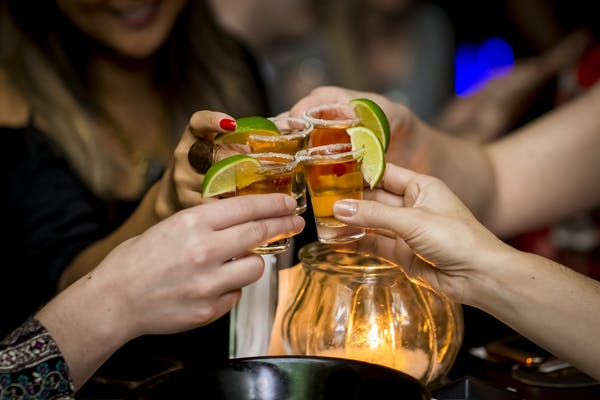 girls taking tequila shots
