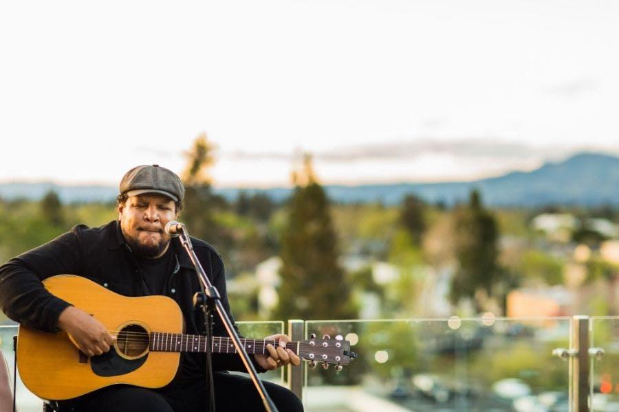 Chris Pierce holding a guitar