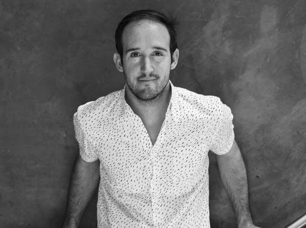 a man wearing a white shirt