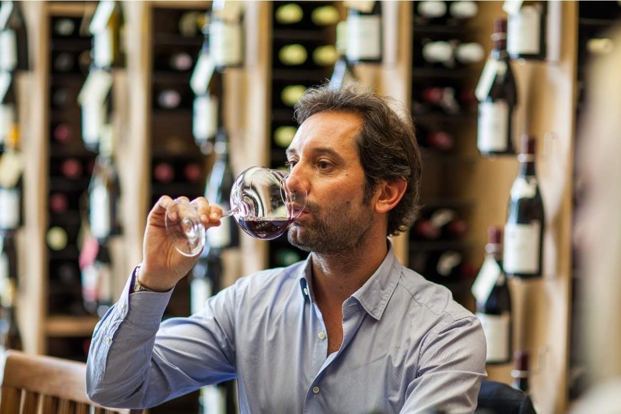 Antonio V. Benanti drinking from a glass