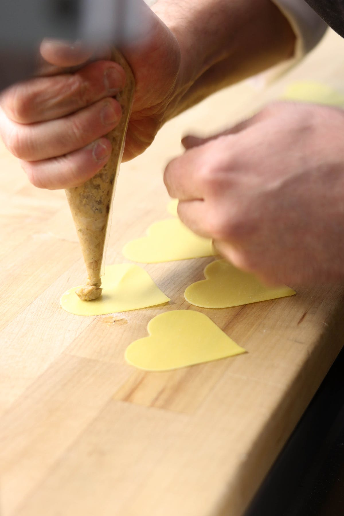 a person sitting on a wooden cutting board