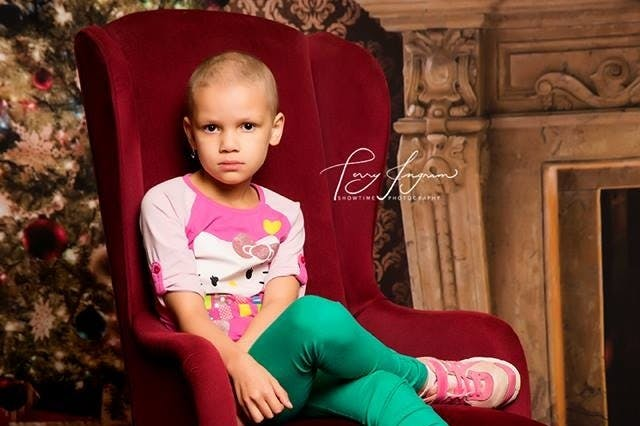a little girl sitting in a chair