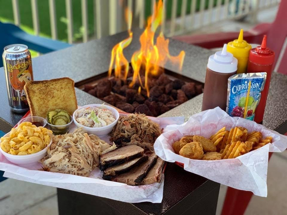 a tray of food on a picnic table