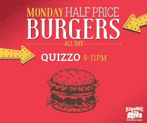 a close up of a logo of a burger Monday sign