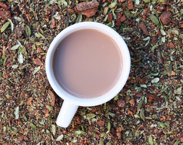 a tea pot sitting on top of a dirt field