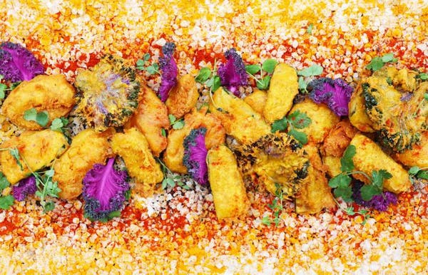 a dish is filled with colorful flowers
