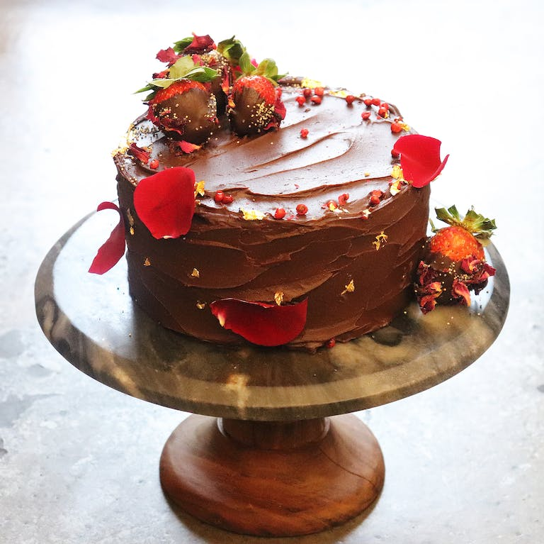 a large chocolate cake sitting on top of a table