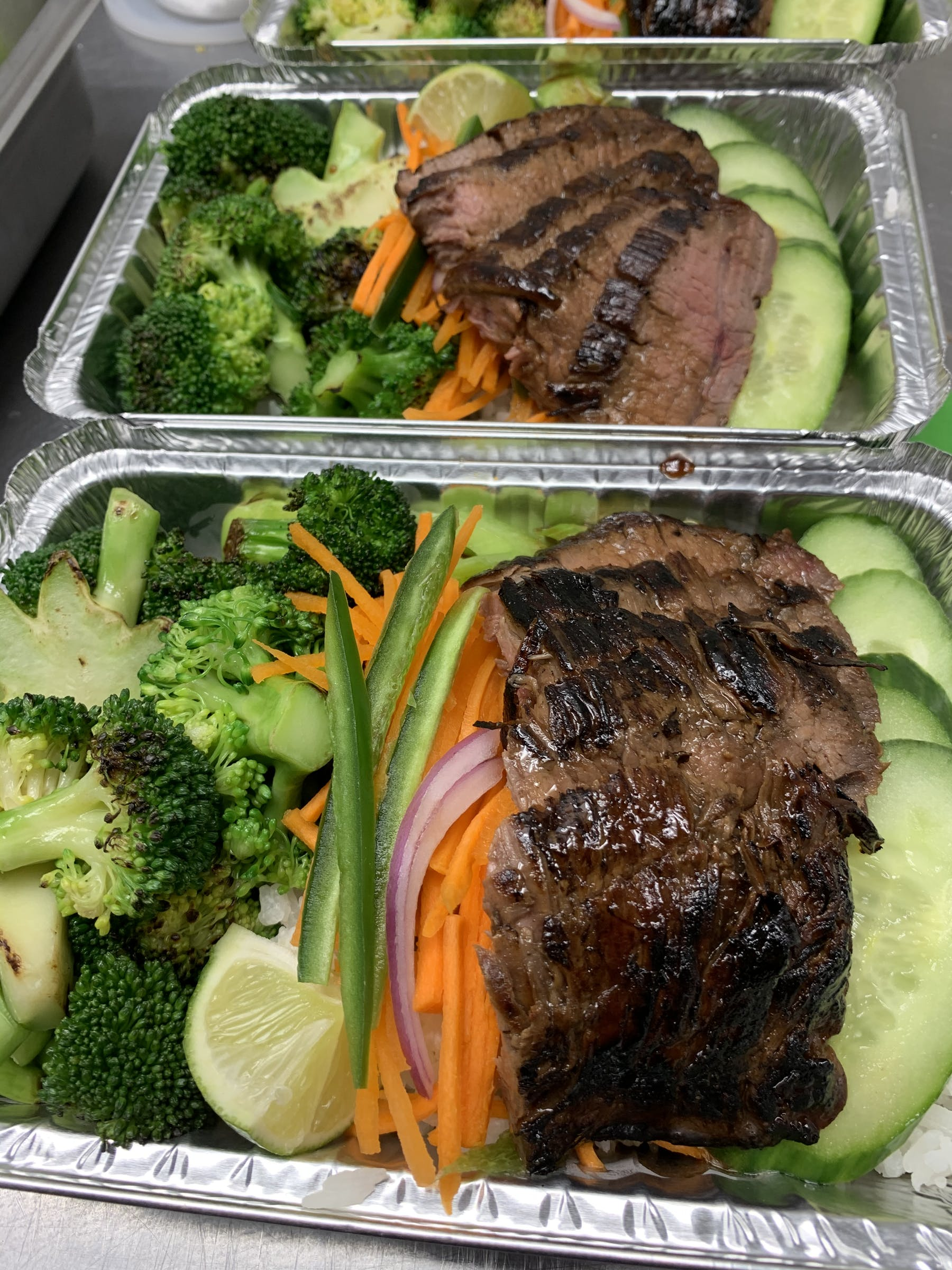 a tray of food with broccoli