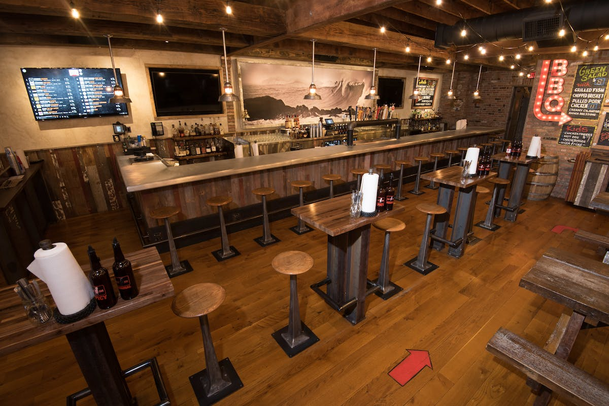 bar area with bar tables and stools