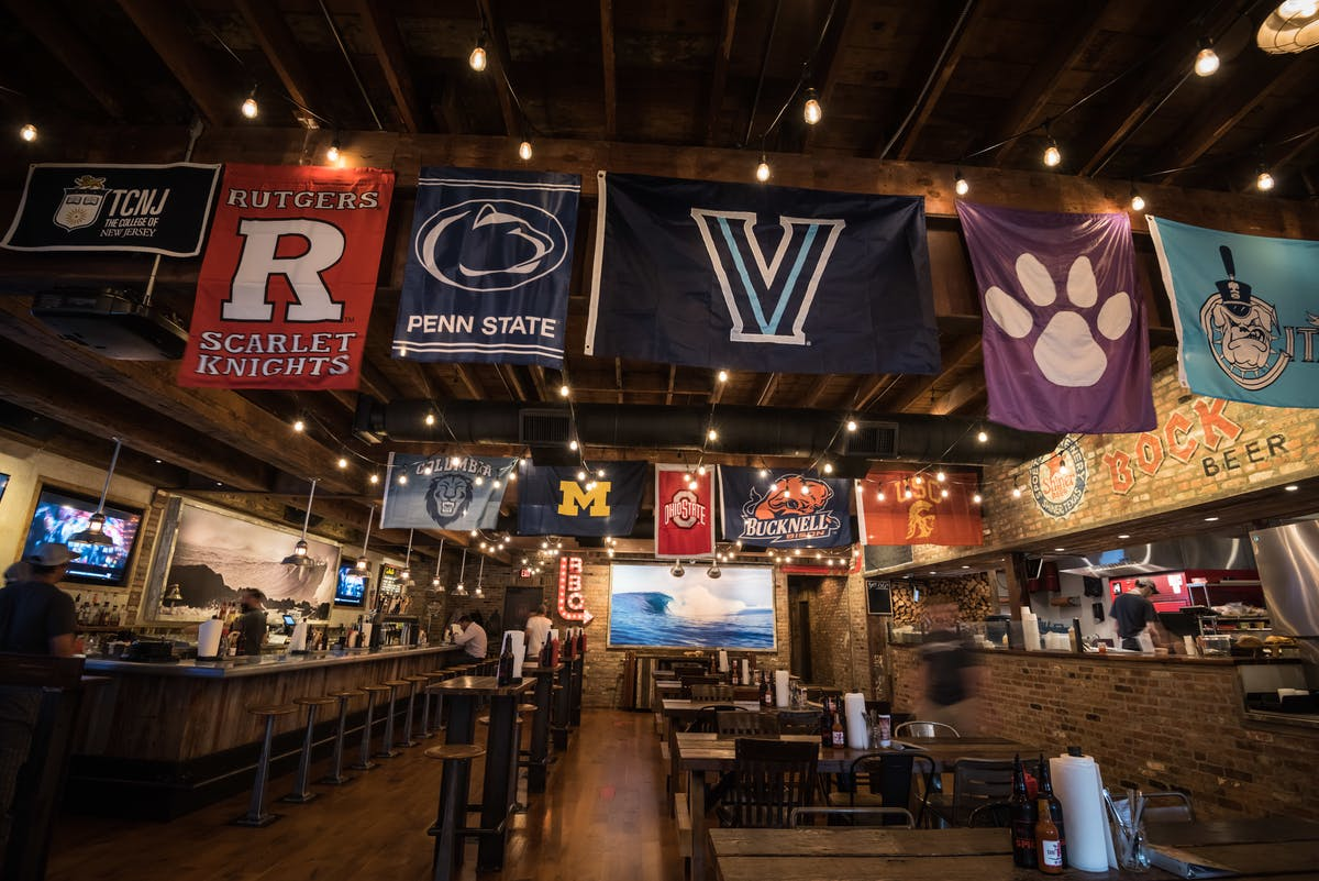 restaurant dining space with sports banners