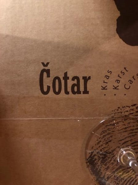 Cotar logo text written on brown paper