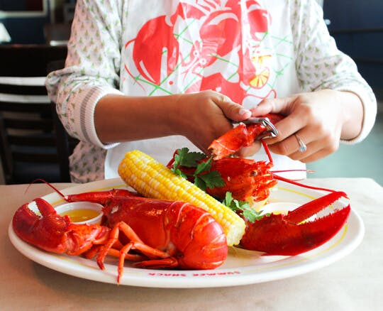 a person eating a lobster