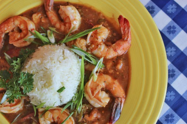 a plate of food with rice, shrimp, and vegetables