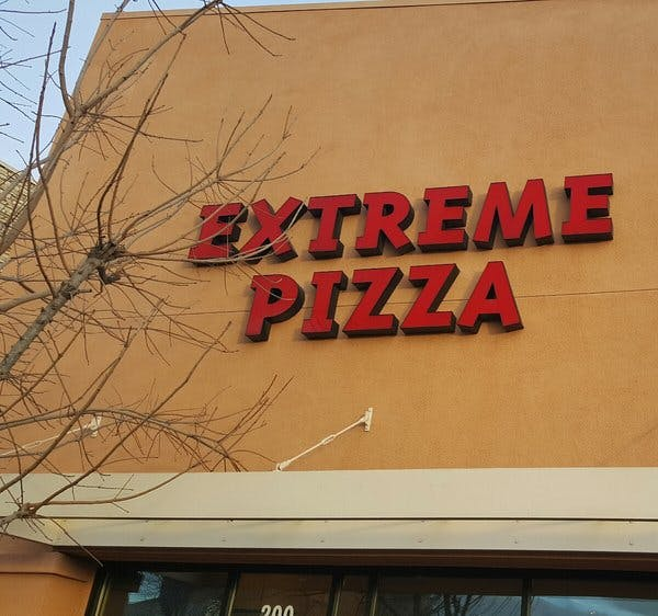 Extreme Pizza sign above the store