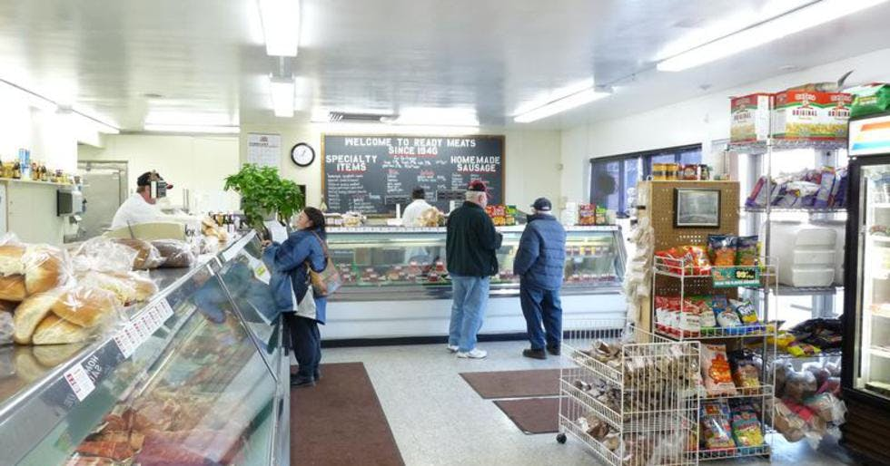 a person preparing food inside of a store