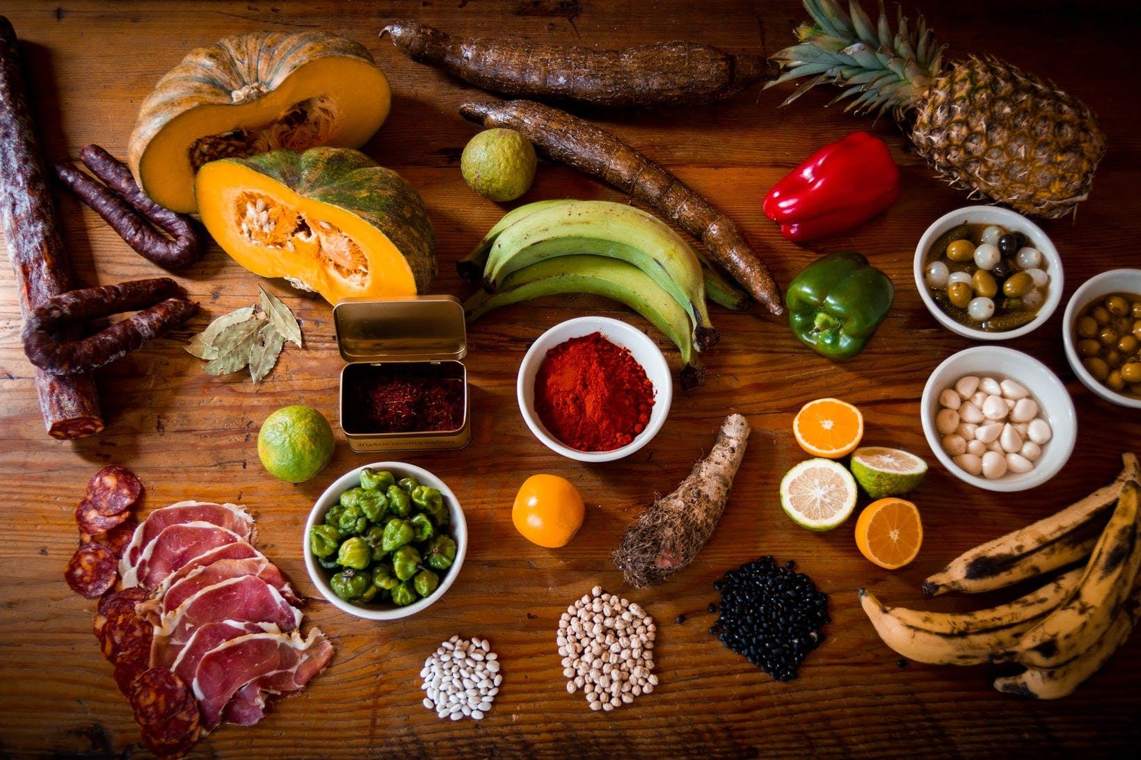 a wooden table topped with different types of food