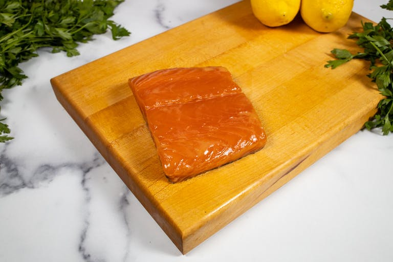 a piece of cake sitting on top of a wooden cutting board