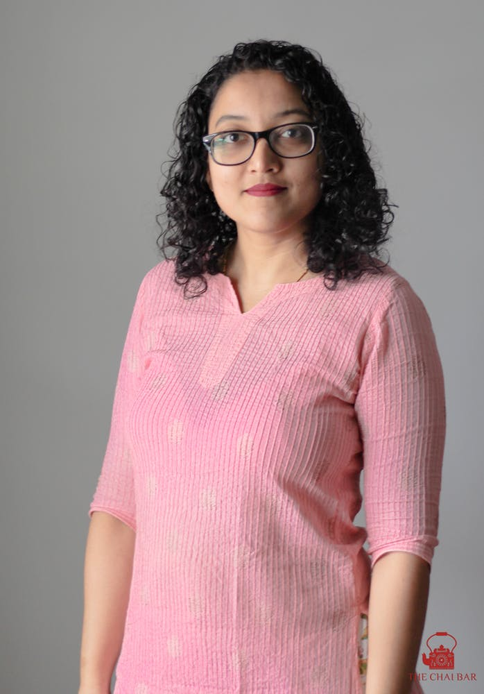 a person wearing a pink shirt