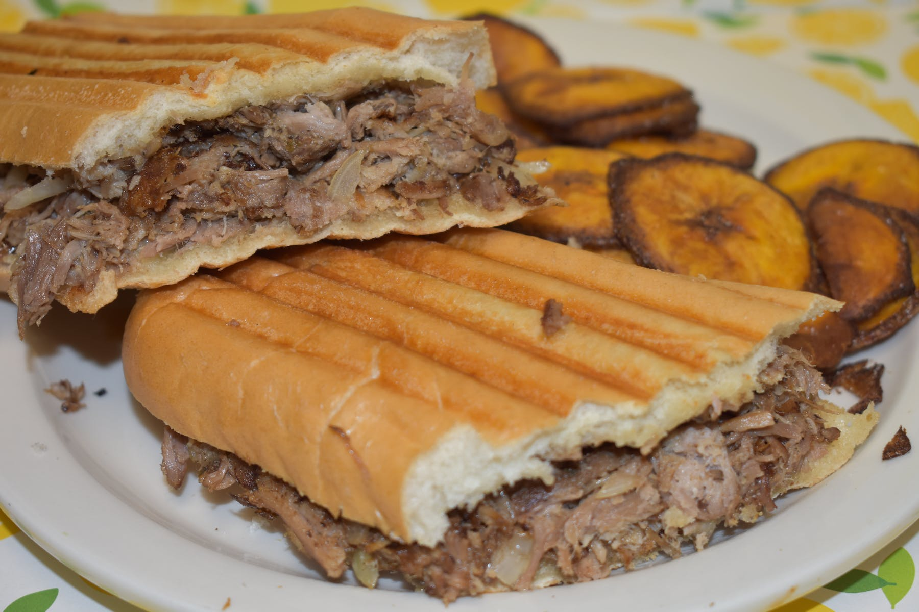 a sandwich with fried plantain slices