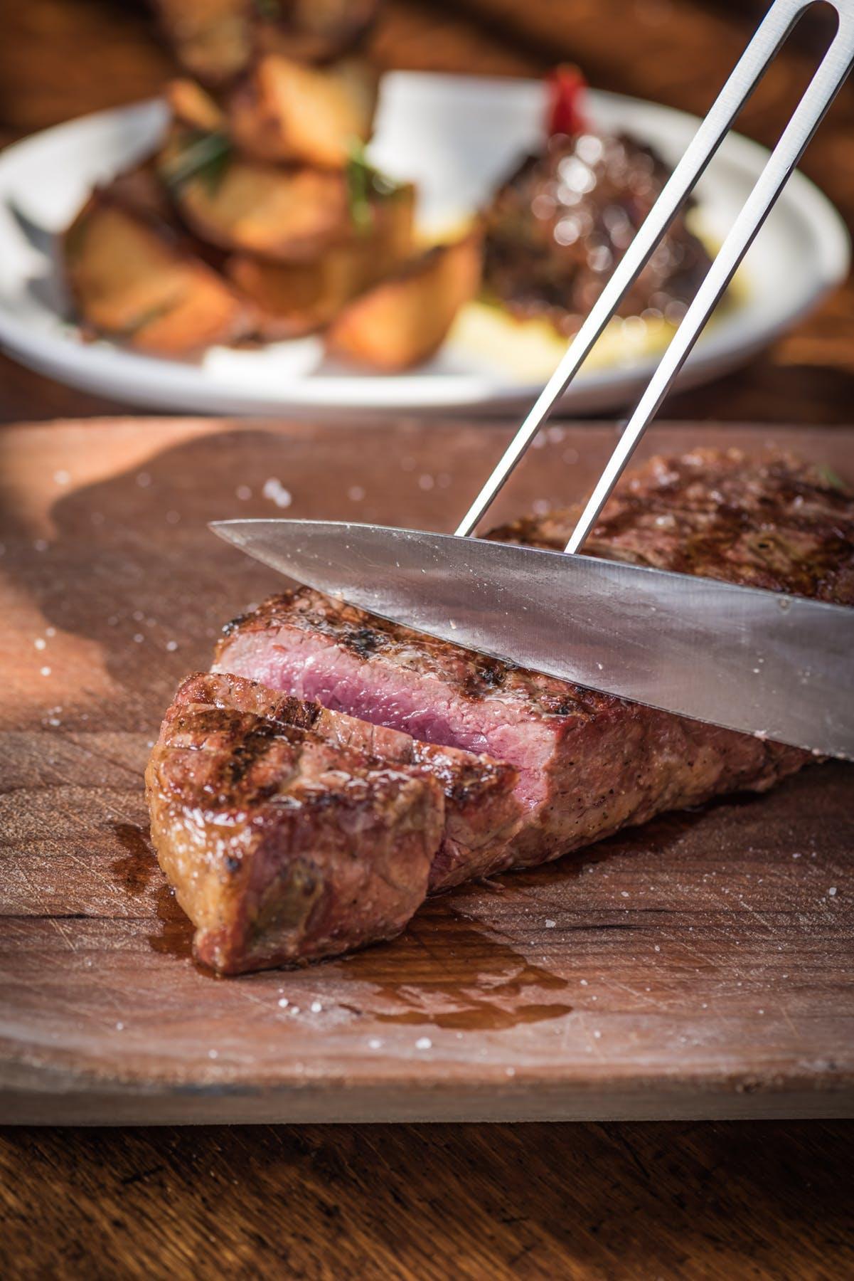 slicing a steak