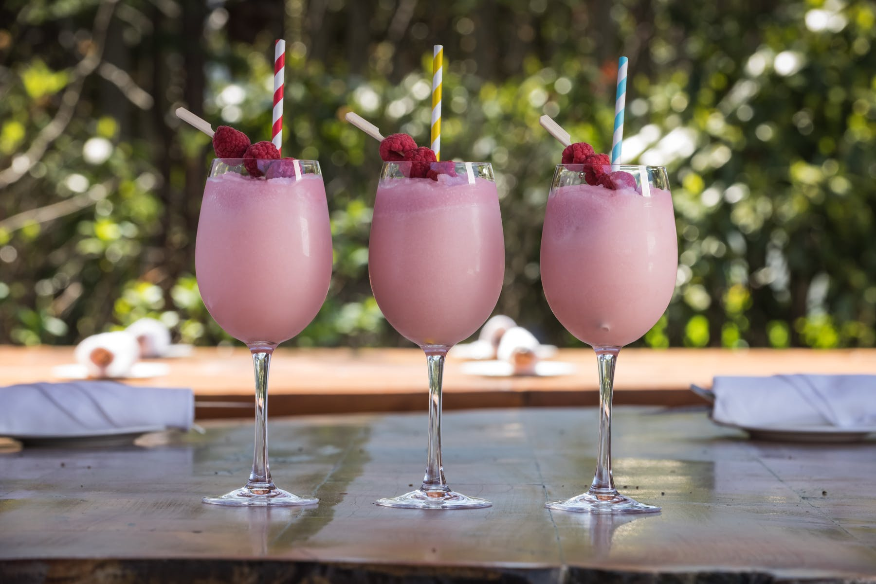three pink cocktails