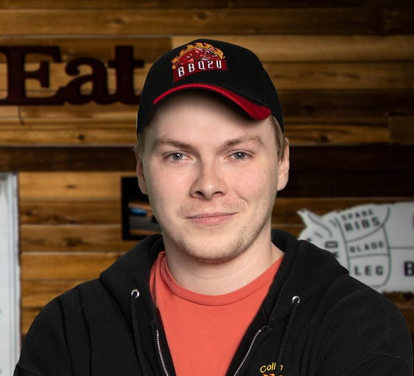 a person wearing a hat and smiling at the camera
