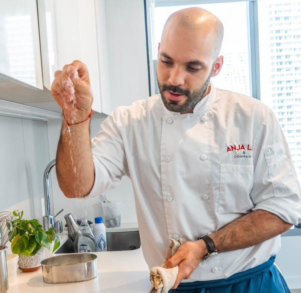 a man preparing food in a kitchen