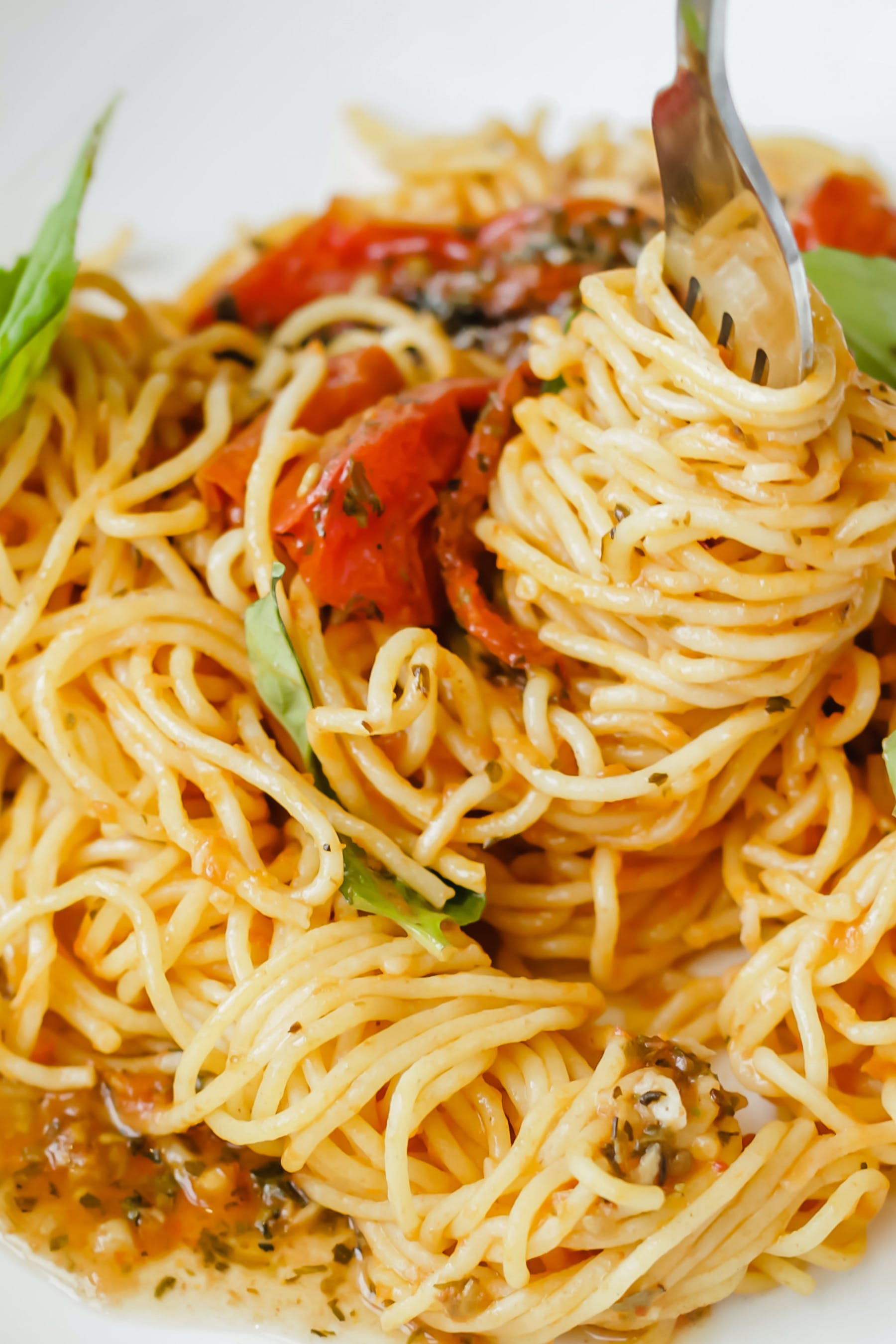 a close up of pasta in a white dish